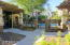 The pool, fitness center & a BBQ ramada are clustered together nearby.