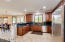 LARGE OPEN KITCHEN WITH GRANITE COUNTERTOPS AND STAINLESS STEEL APPLIANCES