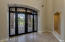 Elegant iron and glass entry door.