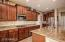 Custom Cabinetry with Walk-In Pantry and Stainless Appliances