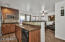 Open kitchen and island. Great for entertaining...cooking and talking to your guests! Sliding glass door leads to the covered patio and pavers