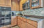 Double wall oven, electric cooking range and microwave and lovely glass tile! BAM!