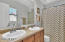 Double sinks, full bath and shower off the master bedroom