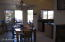 Right off the kitchen is the dining area with a patio door and bay window.