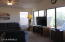 Notice the wall of windows in the living room to take advantage of the fabulous views of the Superstition Mtns.