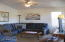 High vaulted ceilings and ceiling fans throughout. Some furnishings can be included in the sale.
