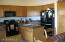 Lots of maple cabinets, black appliances, new fridge w/ water & ice and island.