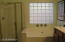 Notice the private, glass block window above the tub & the separate walk-in shower.