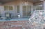 Covered back patio has been extended with huge flagstone.
