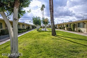 Community courtyard. End unit with 2 bedrooms & 2 baths.