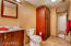 This downstairs bathroom has a full size shower and access to the backyard pool area.