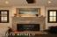 GAS FIREPLACE W/ STONE SURROUND AND MANTLE