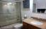 2nd bathroom with granite & glass sliding shower/tub doors