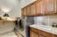 Large laundry with hanging area,cabinets and sink