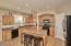 Kitchen features granite countertops, black appliances & kitchen island.