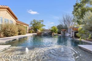 Sparkling California pool and spa with multiple water features.