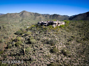 Total privacy, seclusion, at this mountaintop enclave, surrounded by gorgeous saguaro-studded 54 acres.