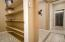 CUSTOM WALK IN PANTRY with tons of storage area.