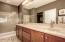 Master bath with double sinks and frameless shower door