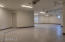 Sommer garage door openers, tiled baseboard, beautiful epoxy floors and a 220 volt plug for electric vehicles.