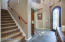 Absolutely amazing entry with medallion tile at entry , vaulted ceilings and beautiful Chandelier above with arched entryway.