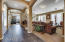 Recessed lighting, columns, beautiful architecture leading to the rest of the home