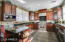 Cherry wood cabinets, crown molding, lge 6 burner gas stove top and s/s applicances.