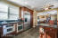 Multi wall ovens, slide out cabinets, under mount sinks, wood blinds.