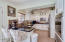 All you can ask for here: granite counters, backsplash, breakfast bar