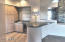 Bar Area Between Formal Living Room and Kitchen, Features Sub Zero Wine Fridge.