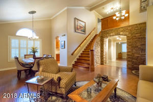 Formal Family/Dining Room with Grand Custom Hand-Crafted French Inspired Stairway