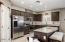Gorgeous kitchen with large island, granite & upgraded cabinets