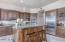 NEW CUSTOM CABINETRY THROUGHOUT THE HOUSE, NEW RAISED ISLAND AND COUNTER SPACE. MANY UPGRADES UNDER $500K