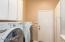 BRIGHT AND WHITE LAUNDRY ROOM WITH LOTS OF BUILT-INS. LOOKS LIKE NEW. WASHER/DRYER HOOK-UP ONLY