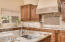 Large kitchen island has prep sink and disposal