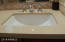 Quartz counters and undermount sinks in all baths