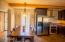 Lot of extras. The kitchen ceiling was raised, designer-stainless range vent installed, chiseled granite counter, chocolate saltillo tile and viga beams, plus solid cherry cabinets. Plantation shutters on the window complete the look