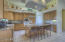 Open Kitchen with gas cooktop, walk in pantry and plenty of cabinets