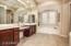 DUAL SINKS, RAISED VANITIES, MAKE UP AREA, JETTED TUB, PLANTATION SHUTTERS, TV OUTLET