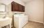 LARGE UTILITY ROOM WITH SINK, WASHER, DRYER REMAIN