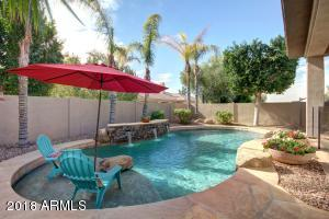Pool with a flagstone sunning deck.