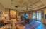 Large office/bedroom 4 with custom cabinets, French doors and hardwood floors.