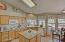 This spacious kitchen offers plenty of cabinet space, dual ovens, granite counter tops and a center island with lots of natural lighting from the beautiful bay windows