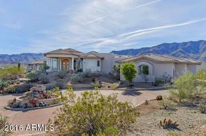 Beautiful custom hilltop home with 360 degree views nestled in the foothills of South Mountain in Phoenix.