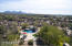 Spectacular aerial view of the property and background vista