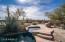 Heated pool and spa with waterfalls and spill over spa to pool. Claim your bit of paradise in this one of a kind home