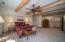 Master bedroom en suite with ceiling fan, wooden ceiling beams.