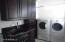 BEAUTIFUL LAUNDRY ROOM W/CHERRY CABINETS