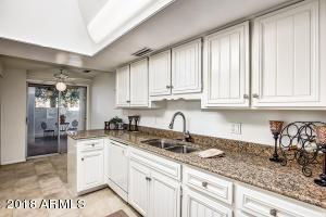 White cabinets. Eat in kitchen area. Inside laundry.