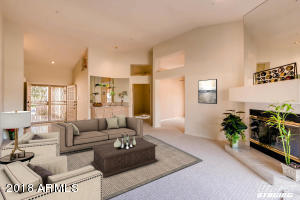 Soaring ceilings and a huge room. Cozy fireplace, nice architectural accents. Virtually staged.